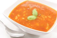 Tomato soup with basil leaves Royalty Free Stock Images