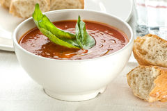 Tomato soup with basil leaves and bread Royalty Free Stock Photo