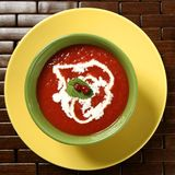 Tomato soup with basil and redcurrant Stock Images