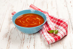 Tomato soup and basil Royalty Free Stock Image