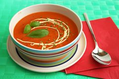 Tomato soup. With basilica herb leaves and mayonnaise Stock Photos