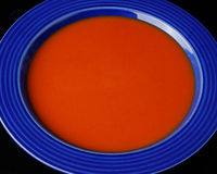 Tomato soup blue bowl Stock Image