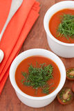 Tomato soup in bowls Stock Photos