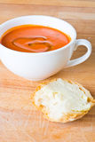 Tomato soup with bread Stock Photography