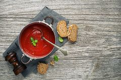 Tomato soup with bread meal royalty free stock image