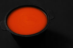 Tomato soup in a cast iron dish Stock Images