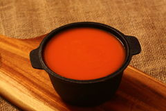 Tomato soup in a cast iron dish Royalty Free Stock Image