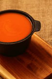 Tomato soup in a cast iron dish Royalty Free Stock Photo