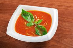 Tomato soup in ceramic bowl Stock Images