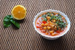Tomato soup with chickpeas and vegetables. Arabic cuisine. Fast food in Ramadan. Tomato soup with chickpeas and vegetables. Arabic cuisine Stock Photo