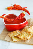 Tomato soup with chili and cheese crisps Royalty Free Stock Image