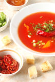 Tomato soup with chilli peppers, sweet peppers, garlic, herbs an Stock Photo