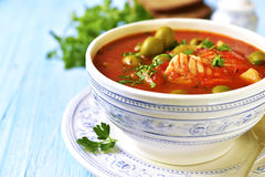 Tomato soup with cod,potato and olives. Royalty Free Stock Images