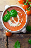Tomato soup with cream and basil Royalty Free Stock Image