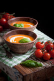 Tomato soup. With cream and fresh basil Royalty Free Stock Image