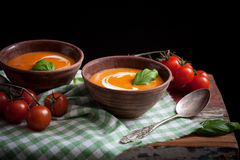 Tomato soup. With cream and fresh basil Royalty Free Stock Photography