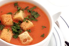 Tomato soup with croutons in bowl on white Royalty Free Stock Images