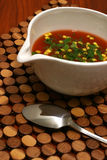 Tomato soup with croutons and spoon. Tomato soup in white bowl Stock Photo