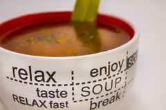 Cup of tomato soup on a light background Royalty Free Stock Photography