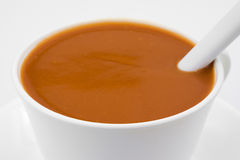 Tomato soup in a cup with spoon Stock Photo