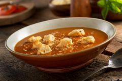 Tomato Soup. A delicious bowl of homemade rustic tomato soup with croutons and parmesan cheese Stock Photo