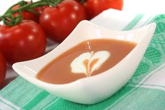 Tomato soup with dollop of cream Stock Photos