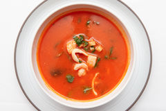 Tomato soup with fish and shellfish shot from above Royalty Free Stock Photos