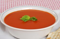 Tomato soup with fresh basil Stock Images