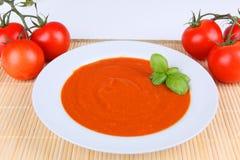Tomato soup. A fresh tomato soup with basil Stock Photos