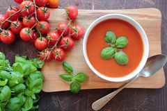 Tomato soup with fresh basil Stock Photo