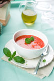 Tomato soup with fresh basil Royalty Free Stock Images