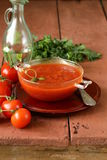 Tomato soup with fresh vegetables and capers Royalty Free Stock Image
