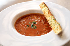Delicious hot tomato soup with garlic bread Royalty Free Stock Photography
