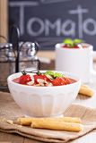 Tomato soup garnished with baked tomatoes Stock Photos