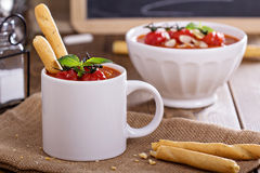 Tomato soup garnished with baked tomatoes Royalty Free Stock Photos