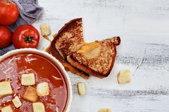 Tomato Soup garnished with Parmesan cheese and croutons Royalty Free Stock Photos