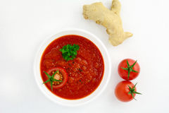 Tomato soup with ginger decorated with parsley Stock Photo