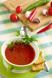 Tomato soup in a green bowl Royalty Free Stock Photos