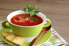 Tomato soup in a green bowl Royalty Free Stock Images