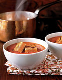 Tomato soup with grilled cheese cr Stock Images