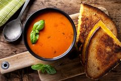 Tomato Soup and Grilled Cheese Sandwich. Delicious homemade tomato soup with a grilled cheese sandwich on rye stock photo