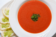 Tomato soup with herb and garlic toasts royalty free stock photo