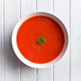 Tomato soup on kitchen table Royalty Free Stock Photos
