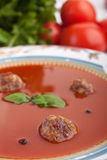 Tomato soup with meatballs and basil Stock Photography