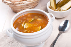 Tomato soup with olives and pickles. Horizontal Stock Photo