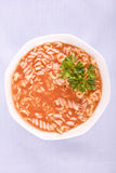 Tomato soup with pasta and parsley Stock Photos