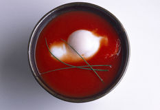 Tomato soup with poached egg Stock Photography