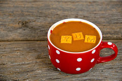 Tomato soup in polka dot cup Stock Photography