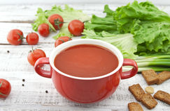 Tomato soup in red ceramic bowl on rustic wooden background. Hea Royalty Free Stock Photos