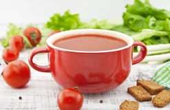 Tomato soup in red ceramic bowl on rustic wooden background. Hea. Lthy food concept. Soft view royalty free stock photography